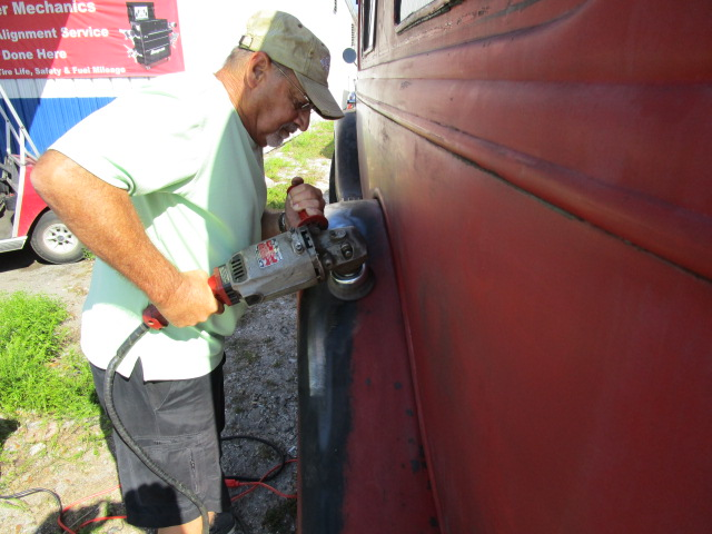 Al is seen here grinding the rust off the truck.  April, 2015